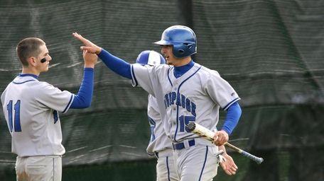 Hauppauge High School's #11 Tyler Scanlon congratulates Bobby