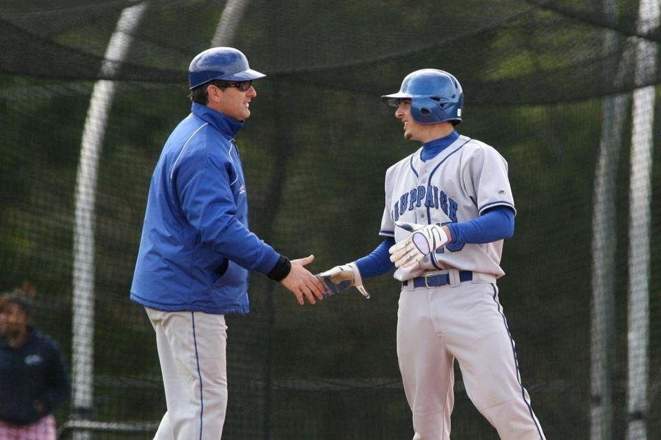 Hauppauge High School's coach Kevin Giachatti congratualates Bobby