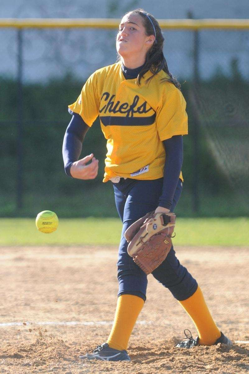 Massapequa High School pitcher #13 Mary Sieber delivers
