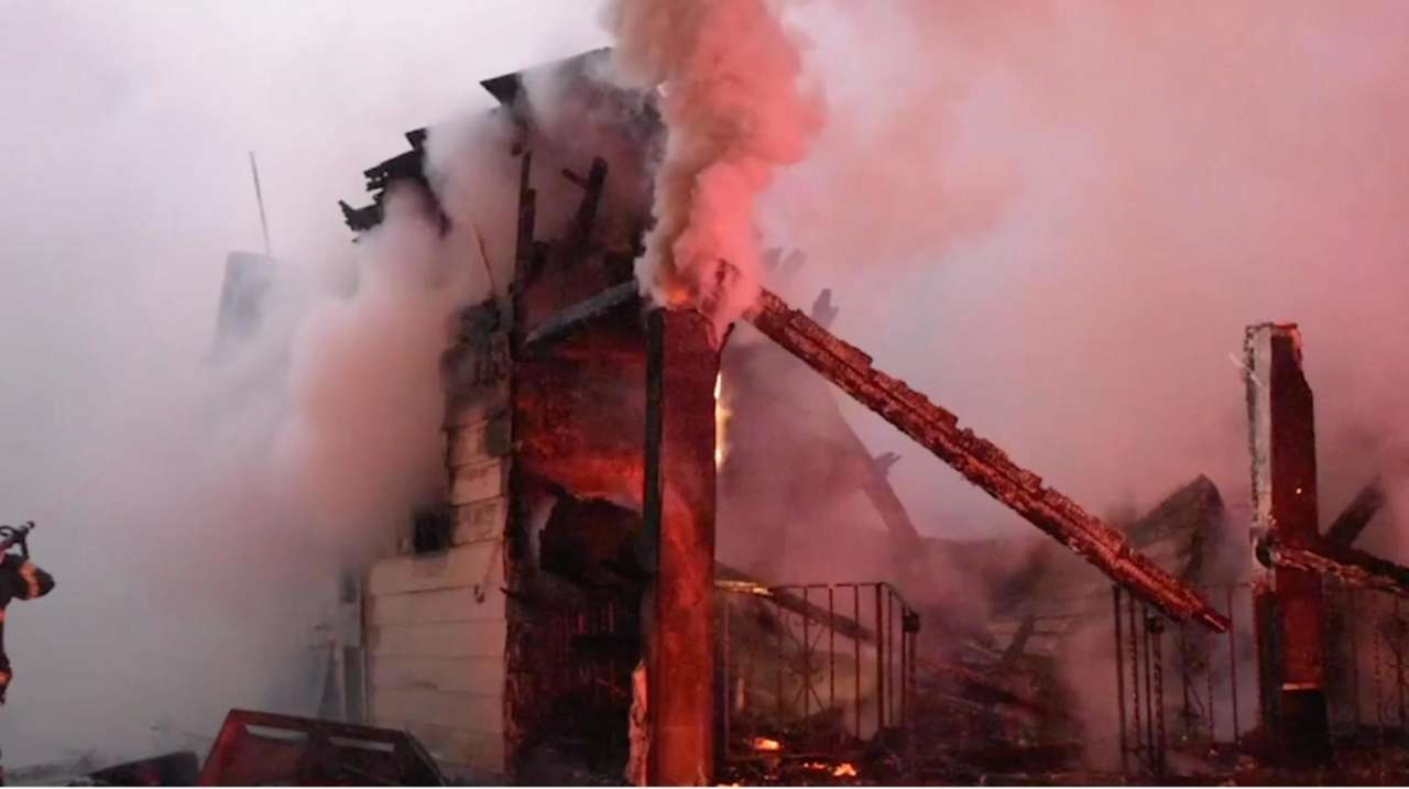 A raging house fire completely destroyed a vacant