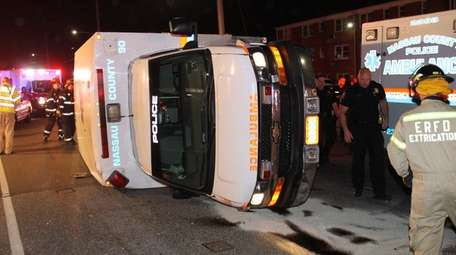 A Nassau County police ambulance overturned Wednesday night