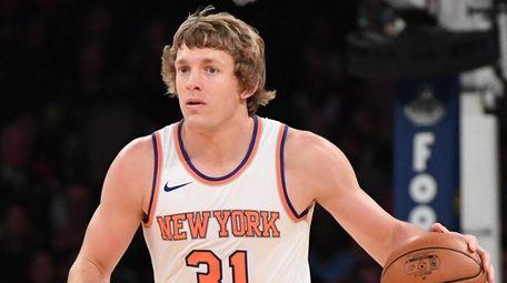 Knicks guard Ron Baker brings the ball up