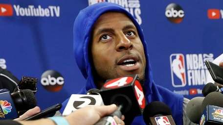 Warriors forward Andre Iguodala responds to a question