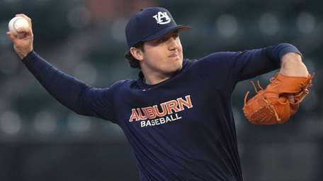 Auburn pitcher Casey Mize throws during the team's