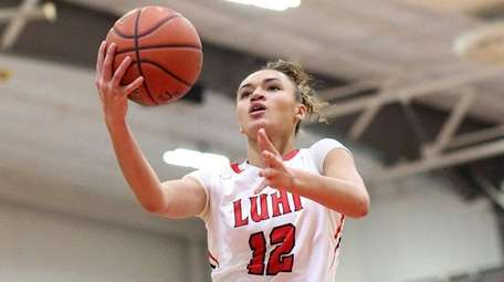 Long Island Lutheran's Celeste Taylor goes up for