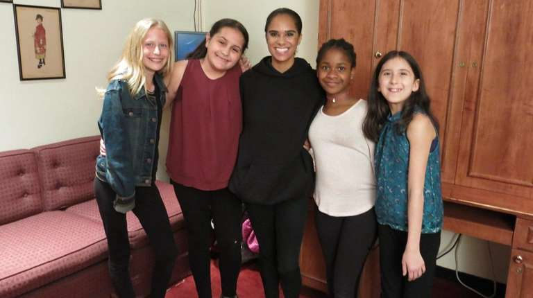 Misty Copeland, center, with Kidsday reporters, from left,