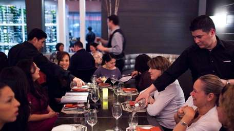 Patrons dine at Two Steak & Sushi Den