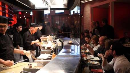 Patrons can dine at the long sushi and