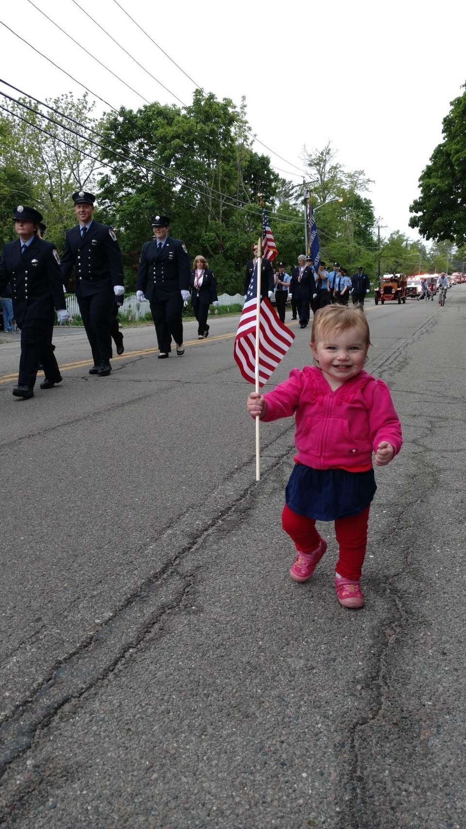 Casey Booth, age 1, marching on the sidelines