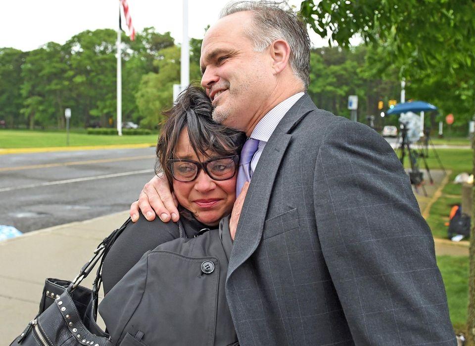 Linda Mangano, embraces her attorney John Carman, outside