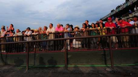 Spectators watch the 2012 Belmont Stakes at Belmont