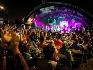 People enjoy popular Pakistani singer Ali Haider, center,