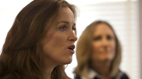 Nassau County District Attorney Kathleen Rice joined members