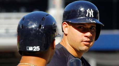 The Yankees' Gary Sanchez talks with teammate Gleyber