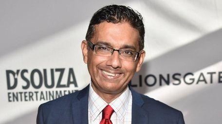 President Donald Trump on Thursday pardoned Dinesh D'Souza,