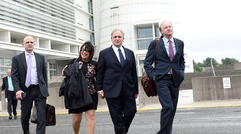 Edward and Linda Mangano, leave federal court in