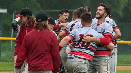 Center Moriches celebrates after defeating Wheatley in the