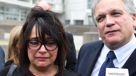 Linda Mangano cries outside federal court in Central