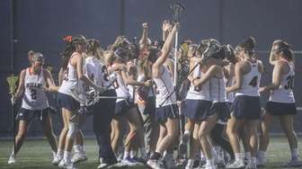 Manhasset celebrates its 14-5 win against Garden City