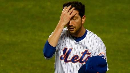 Mets pitcher Jerry Blevins walks to the dugout