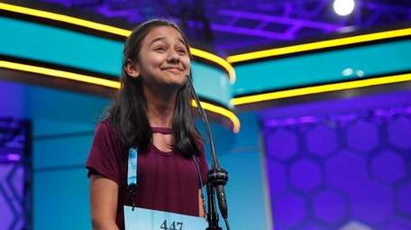 Naysa Modi, 12, from Frisco, Texas, reacts to