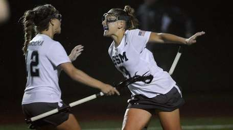 Eastport-South Manor midfielder Kasey Choma, right, celebrates her
