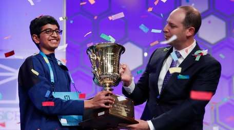 Karthik Nemmani, 14, from McKinney, Texas, holds the