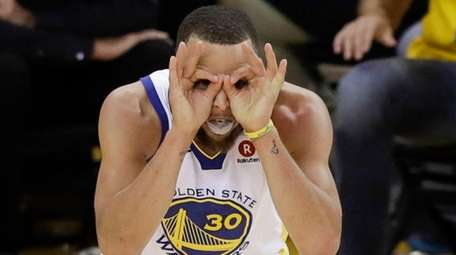Warriors guard Stephen Curry celebrates during overtime of