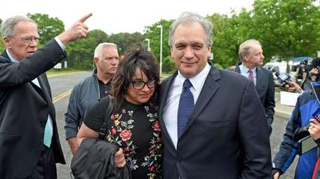 Linda and Edward Mangano outside federal court in