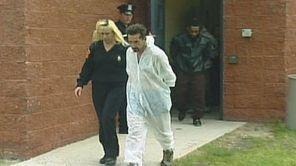 Joseph Creedon leaves the 6th precinct for arraignment