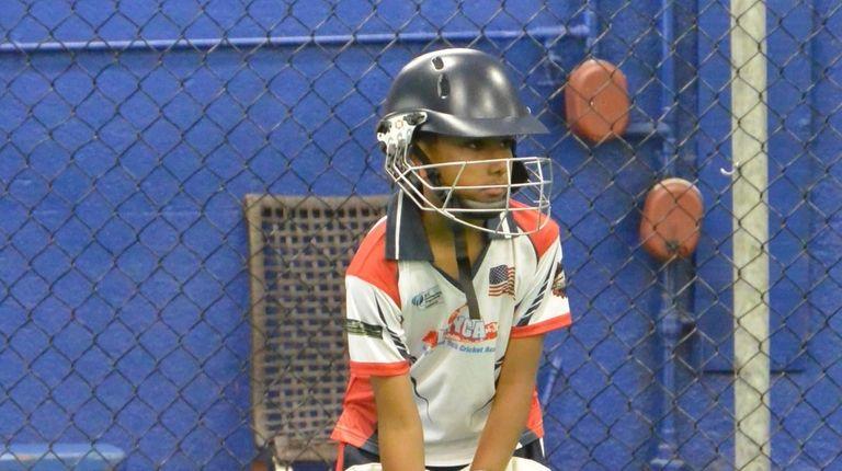 Jay Sarju, 10, of North Merrick, plays cricket