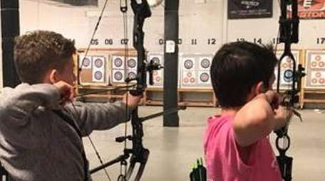 Students practice at USA Archery in Hicksville.