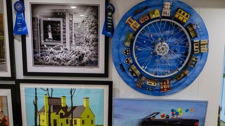 Alan Richards displays some of his artwork in