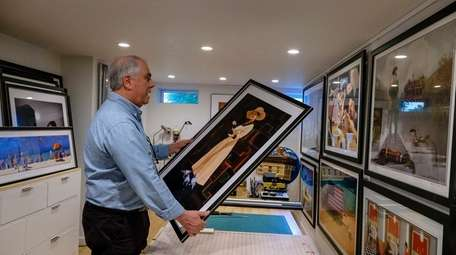 Alan Richards frames one of his pieces in