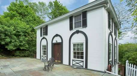 Enter this Roslyn home through double mahogany doors.