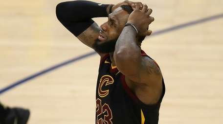 LeBron James of the Cavaliers reacts to a