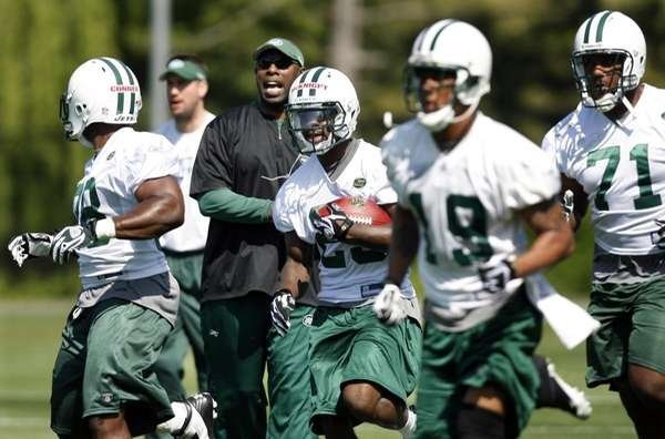 New York Jets assistant coach Anthony Lynn, third
