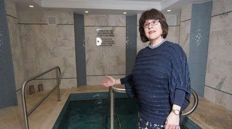 Chaya Teldon, co-director of Chabad Long Island, stands