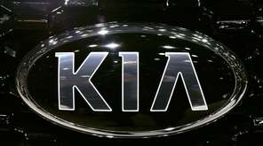 The Kia logo is seen during the Geneva