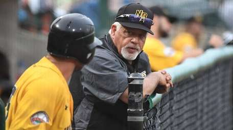 New Britain Bees manager Wally Backman talks with