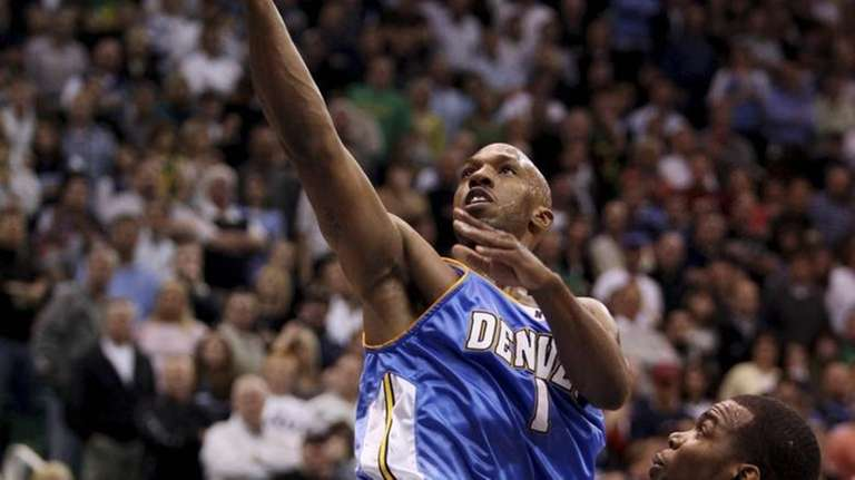 Denver Nuggets guard Chauncey Billups (1) goes to