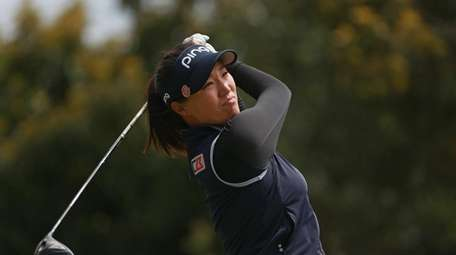 Annie Park watches her tee shot on the