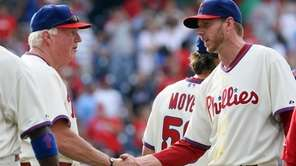 Roy Halladay #34 and manager Charlie Manuel of