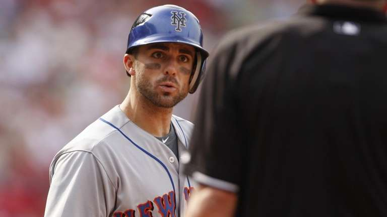 New York Mets' David Wright argues over a
