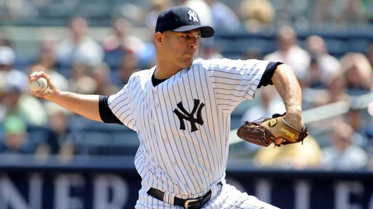New York Yankees pitcher Javier Vazquez throws during