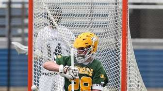 Ward Melville's Collin Krieg (28) makes a save