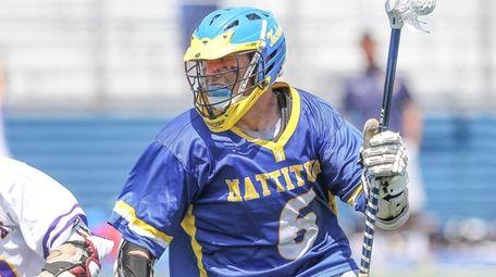 Mattituck's Max Kruszeski carries the ball while being