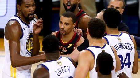 Cavaliers center Tristan Thompson yells at Warriors forward
