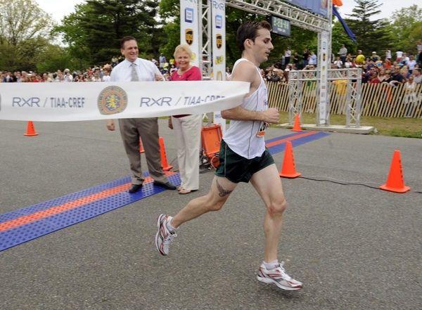 Dan McGrath breaks the tape to win the