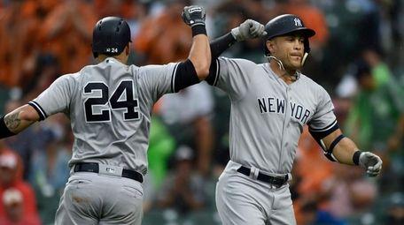 Yankees' Giancarlo Stanton celebrates his home run with